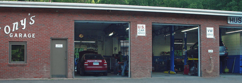 Three open service bays at Tony's Garage.